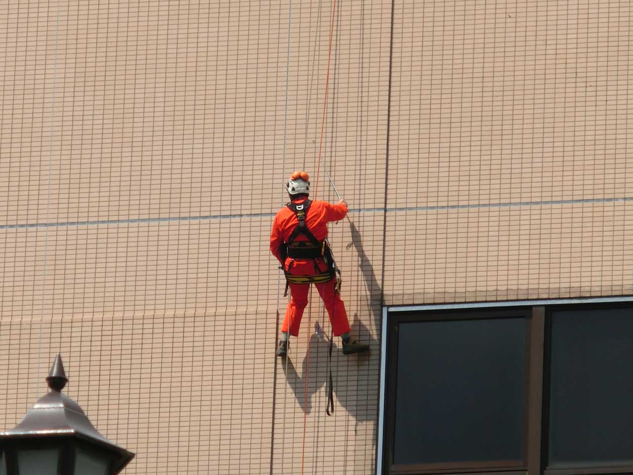 Tile percussion investigation by rope access